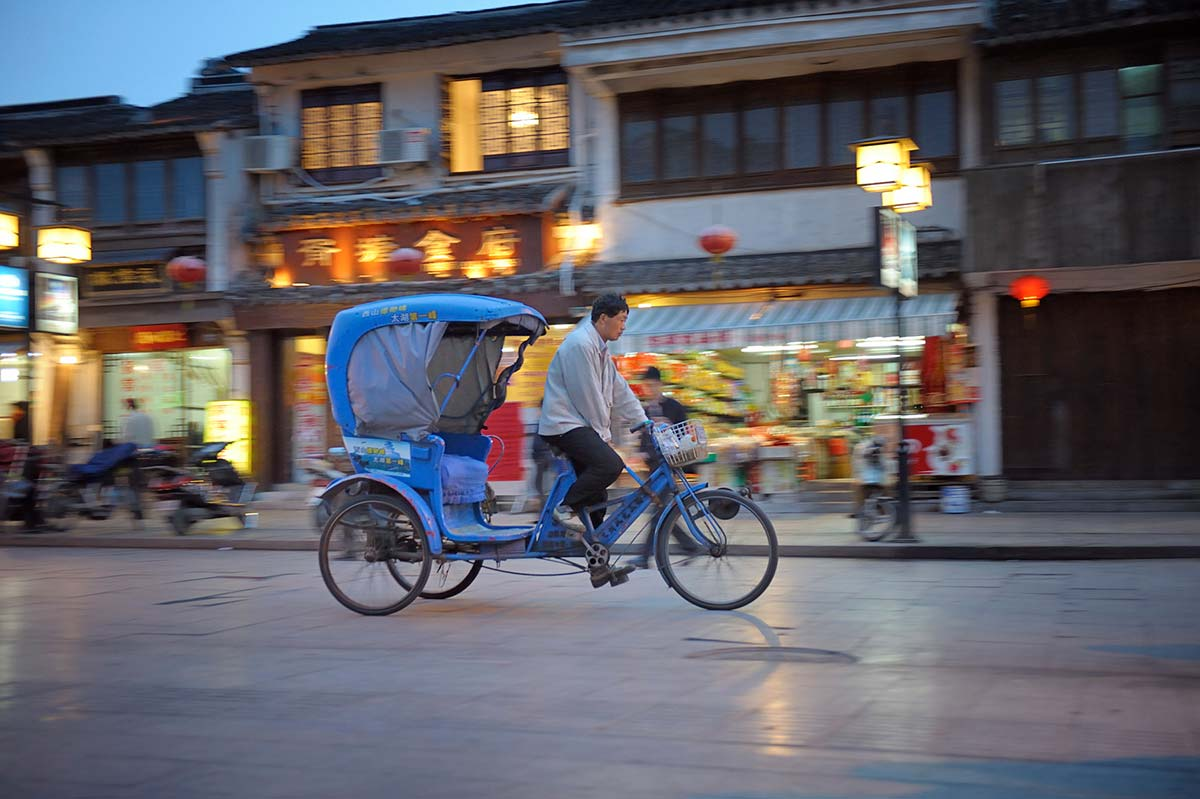 A rickshaw driver in Suzhou, China.